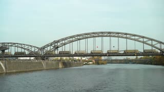Trains crossing bridge over Main river in Frankfurt 4k