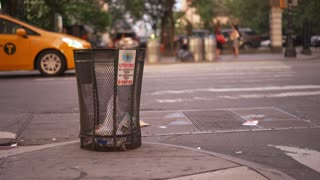 Trash bin on intersection corner in downtown New York City 4k
