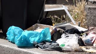 Trash littered on side of street 4k