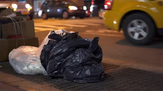 Trash on city sidewalk in downtown New York 4k