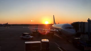 Travel destination at airport with airplane in sunset 4k