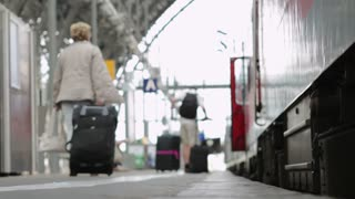 Travelers getting on train