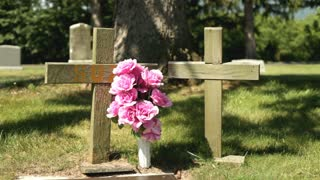 Two wooden crosses at grave