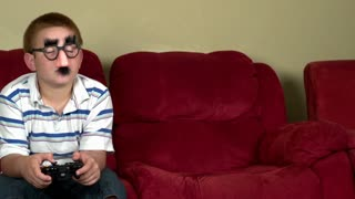 Unknown online gamer playing in living room