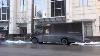 UPS dropping off package at business building downtown Chicago 4k