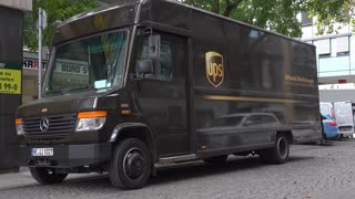 UPS truck delivering package to local Frankfurt Germany business 4k