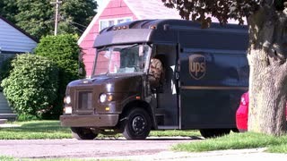 UPS Truck Driving off in Neighborhood
