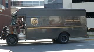 UPS truck pulling away in city