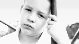 Upset Young Child looking at camera black and white
