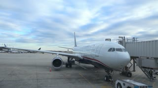 US Airways airplane waiting at terminal gate in PHL airport 4k