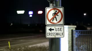 Use crosswalk sign with cars going by in back