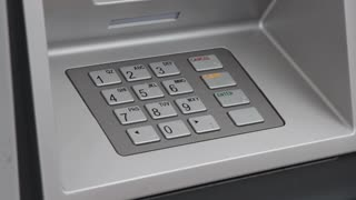 Using keypad at money machine