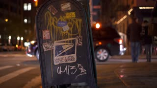 USPS box covered in graffiti on New York City sidewalk 4k