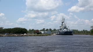 USS North Carolina wide angle seen from across water 4k