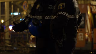 Valencia Police officers standing outdoors in evening hours 4k