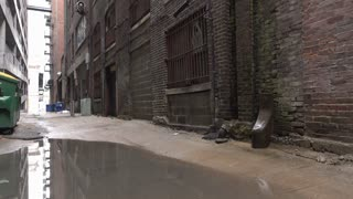 Abandoned street alley during daylight after rainfall 4k