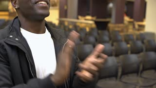 African American male at presentation clapping and cheering 4k
