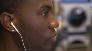 African American male close up on face while listening to music 4k
