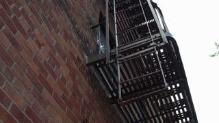 Air conditioner under fire escape of exterior apartment complex 4k