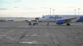 Allegiant flight pushed back from terminal preparing for takeoff 4k