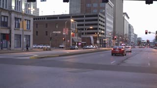 Ambulance going through St Louis downtown at evening time 4k