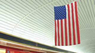 American Flag hanging in Penn Station train terminal 4k