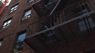 Apartment complex exterior fire escape tilt of building 4k