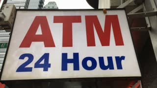 ATM 24 Hour Sign in busy city