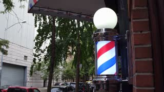 Barbershop light on exterior of building spinning 4k