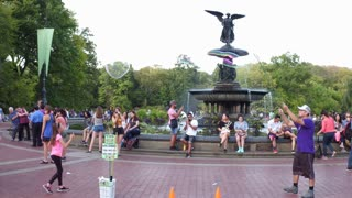 Bethesda Fountain in Central Park with tourists 4k