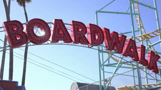 Boardwalk sign at the beach establishing exterior daylight 4k
