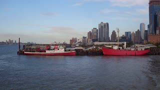 Boats in harbor of Hudson River with NYC in background 4k