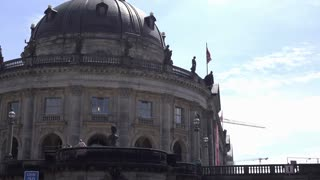 Bode Museum with people waving in Berlin Germany 4k