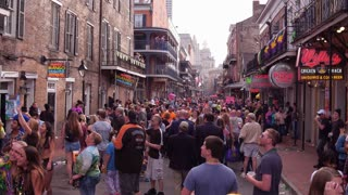 Bourbon Street mid day with people celebrating Mardi Gras 4k
