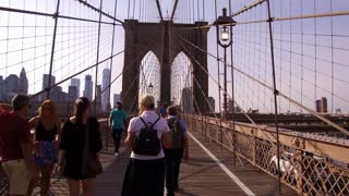 Brooklyn Bridge pedestrians walking on sunny day