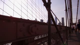 Brooklyn Bridge to city of New York establishing shot