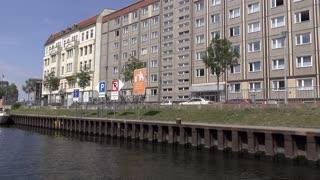 Building and boat establishing shot on Spree river ride Berlin 4k