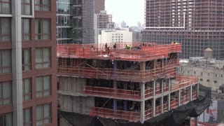 Building construction crew working in downtown Brooklyn New York