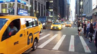 Busy city streets with Taxi cars driving by in NYC 4k
