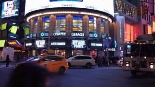 Busy downtown at intersection with flashing lights of New York City 4k
