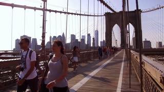 Busy foot traffic of pedestrians on Brooklyn Bridge
