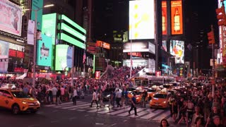 Busy night shot of people in Times Square 4k