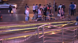 Busy night time pedestrian and street traffic Las Vegas tilt shot 4k