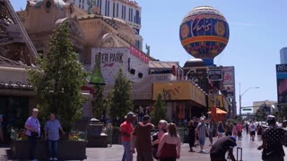 Busy sidewalk in front of Paris Hotel and Casino Las Vegas 4k
