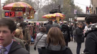 Busy sidewalk with street vendors in New York City 4k
