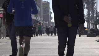 Busy Venice Beach boardwalk with people walking 4k