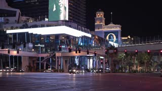 Cars at intersection with Bellagio Casino in background 4k