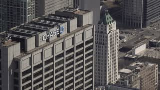 Chase Tower in downtown Chicago exterior aerial establishing 4k