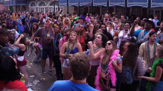 Cheering for beads on Bourbon Street tourists Mardi Gras 2018 4k