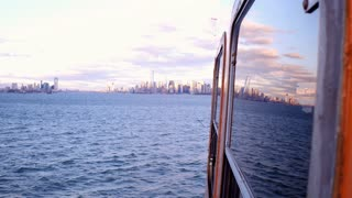 City reflection in window of boat NYC 4k